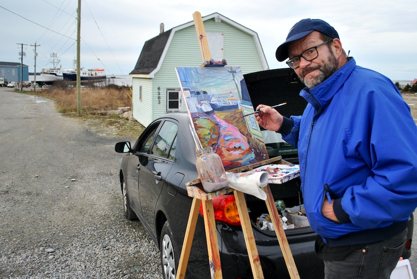 South Shore artist Andre Haines takes a quick break to look at the camera while painting on location in Woods Harbour in mid-December.  KATHY JOHNSON PHOTO