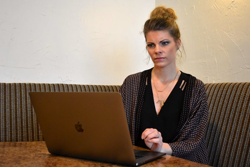 Shanna Joudrey, owner of Details Events & Design Studio, frowns as she tries to access the Internet. Like many people in rural Nova Scotia, she doesn't have access to the basic Internet speeds outlined by the CRTC.