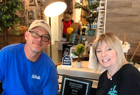 Knut Weissbach and Jane Smith, owners of Baytub in Mahone Bay, with their dealer excellence award. CONTRIBUTED
