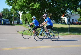 Julien and Edna Gallant train in Abram-Village for the Century Ride for Wishes in September. The Gallants will cycle from Egmont Bay to Moncton, N.B., the weekend of Sept. 18 to raise money for the P.E.I. Chapter of Make-A-Wish, which recently unified with the Children's Wish Foundation.