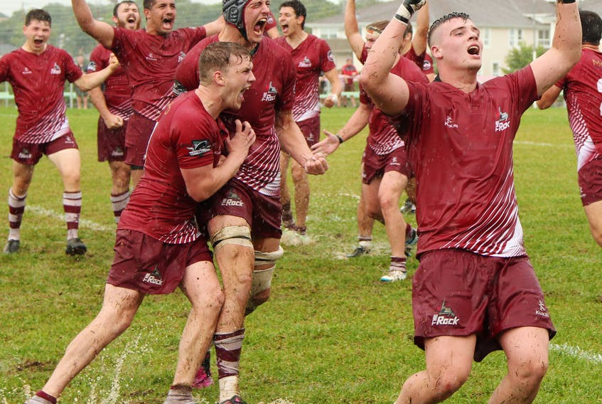 Members of the Atlantic Rock celebrate after winning the 2019 Canadian under-19 rugby championship final at Swilers Rugby Complex in St. John's, where they defeated the Ontario Blues 21-5 for their first national U19 title in nine years. — Colin Squires