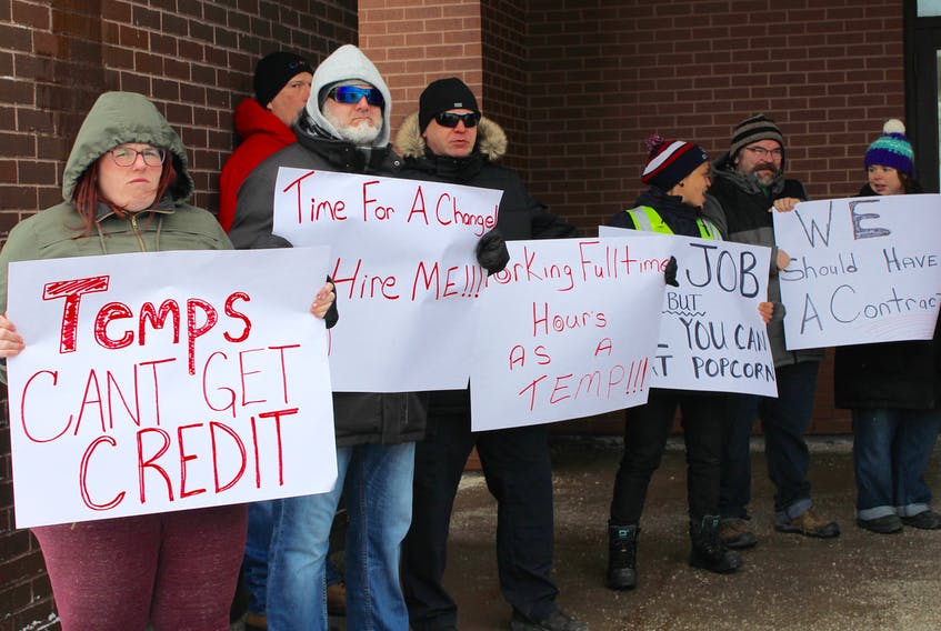 Canada Post workers demonstrated outside the Kenmount Road location on Thursday. They say temporary workers — many of whom have been with the Crown corporation for five to 10 years — receive no benefits, job security, raises or rotation of duties, which prevents repetitive strain. -JUANITA MERCER/THE TELEGRAM