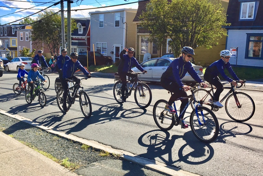 This file photo shows Royal Newfoundland Constabulary officers cycling up Parade Street during the 2018 RNC Tour the Rock event. Beginning in a few weeks, cyclists and pedestrians will have more space to use on Parade Street, as well as three other St. John's streets, after city council voted Tuesday to change some transportation networks to improve safety and allow physical distancing during the pandemic. -TELEGRAM FILE PHOTO