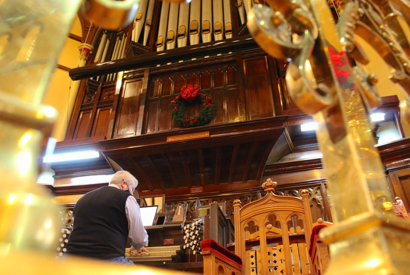 Executive director of the Basilica Heritage Foundation, John FitzGerald, plays the pipe organ at the St. Andrew's Presbyterian Church. — Andrew Waterman/The Telegram