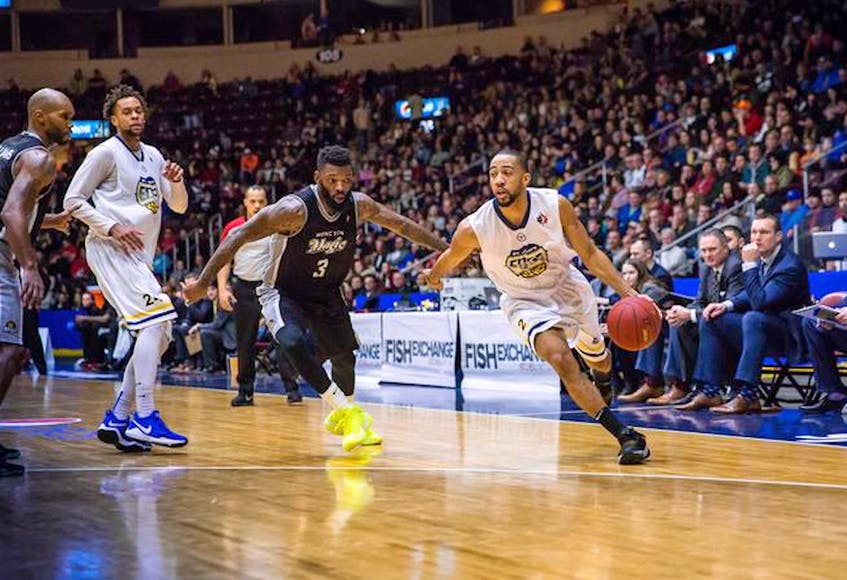 In this file photo, St. John's Edge guard Coron Williams (right) drives the ball down the court during a game against the Moncton Magic at Mile One Centre. The Edge played out of Mile One from 2018 to 2020, but didn't operate in 2020-21 because of the COVID-19 pandemic. —  St. John's Edge file photo/Jeff Parsons