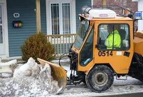 A City of St. John's snowclearing crew member clears and salts a section of sidewalk on Empire Avenue in this file photo. -TELEGRAM FILE PHOTO