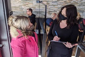 Restaurants in the St. John's metro area are concerned about the possibility they'll need to pivot away from in-person dining as local cases of COVID-19 rise. A diner is shown above entering a Nova Scotia restaurant. — SaltWire Network file photo