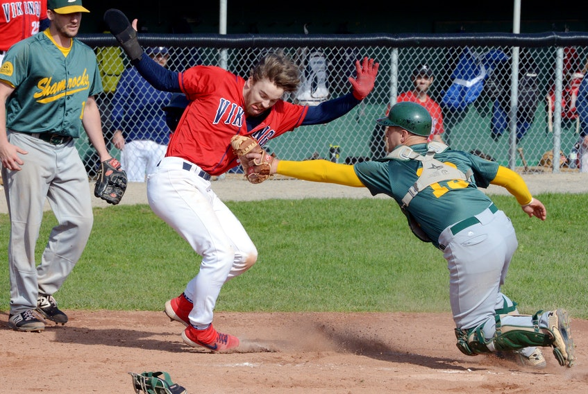 Eric McKay of the Gonzaga Vikings is tagged out at home plate by Shamrocks catcher Scott Stockley during baseball action at St. Pat's Ball Park Saturday afternoon. It turned out the Vikings didn't need the run as they beat the Shammies 5-3 to tie the St. John's senior baseball final at a game apiece. — Keith Gosse/The Telegram
