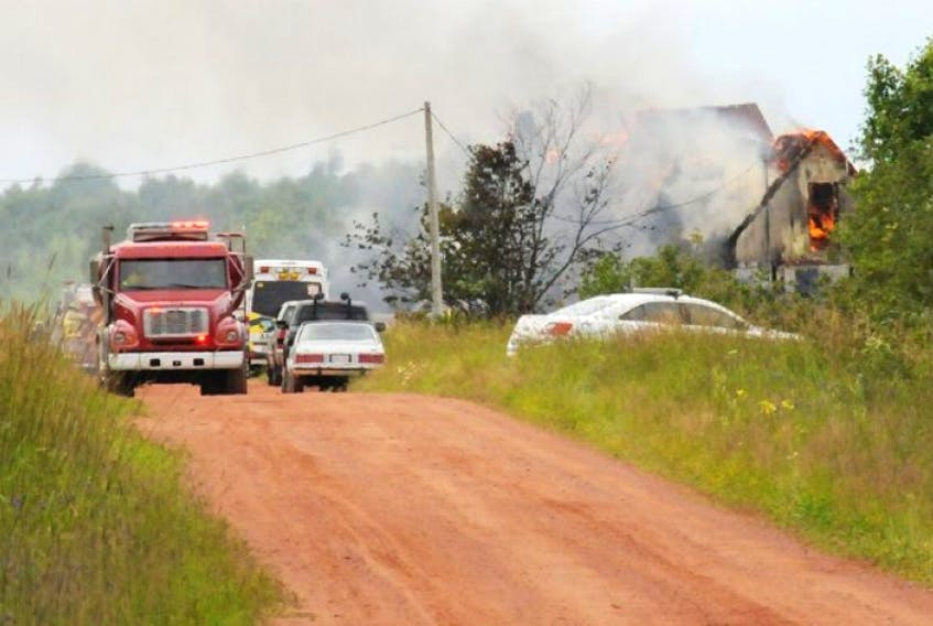A house burns in St. Nicolas on Thursday, July 23, 2015