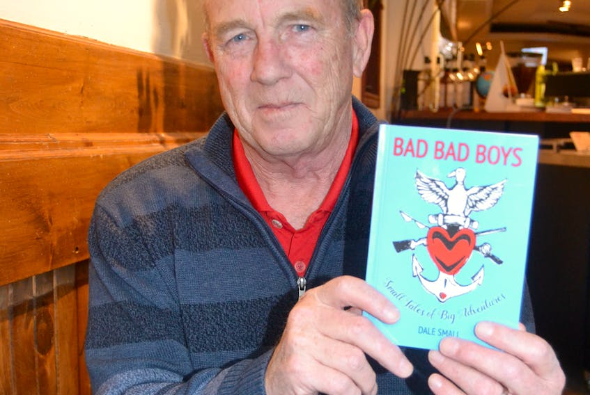 """First-time author Dale Small holds a copy of his new book, """"Small Tales of Big Adventures"""".  He grew up in Summerside. SALLY COLE/THE GUARDIAN"""