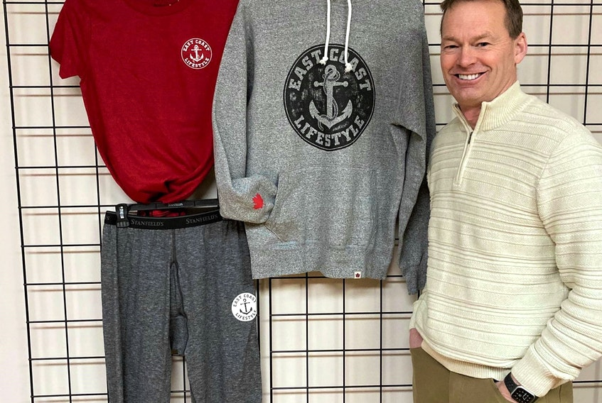 Rob Newcombe, vice-president of marketing and sales for Stanfield's, stands beside a few of the items which are part of a winter collection, resulting from a partnership between Stanfield's and East Coast Lifestyles.
