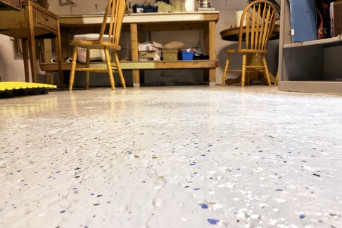 A few hours work rolling on an epoxy floor coating can make any unfinished basement much more inviting. The plastic flakes are added after application but before the epoxy has cured.