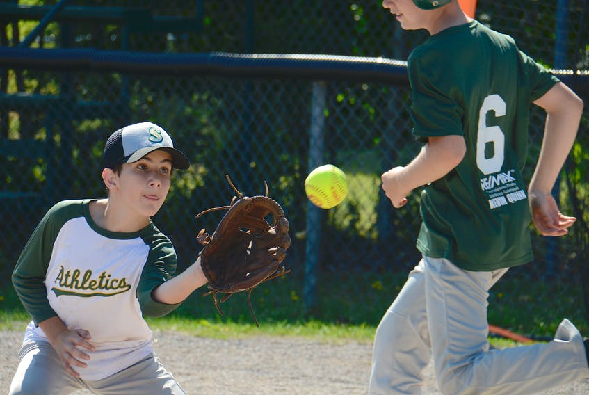 Daniel Ferguson prepares to catch the ball while covering first base on a bunt during a recent Kevin Quinn Re/Max Stratford Stealers boys' softball team practice.