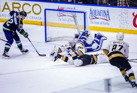The Maine Mariners' Morgan Maison-Adams (left) scored past a sprawling Newfoundland Growlers netminder Maksim Zhukov on a power play with 73 seconds remaining in the game to give the Mariners the winning goal in what would be a 3-1 ECHL victory Saturday night at Mile One Centre. It was Newfoundland's first loss at Mile One after an ECHL-record 19 home-ice wins. — Newfoundland Growlers photo/Jeff Parsons