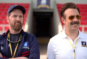 Brendan Hunt and Jason Sudeikis monitor the team's progress in Ted Lasso. The first season is now streaming on Apple TV Plus. APPLE