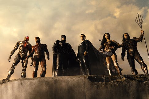 The assembled DC heroes of Zack Snyder's Justice League ready to fight a big-horned alien before he uses some cubes to blow up Earth. - BELL MEDIA