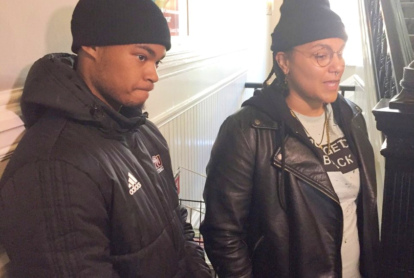Activists Trayvone Clayton and Kate Macdonald speak to the media about the legal opinion on street checks presented to the Halifax police commission Monday afternoon. FRANCIS CAMPBELL
