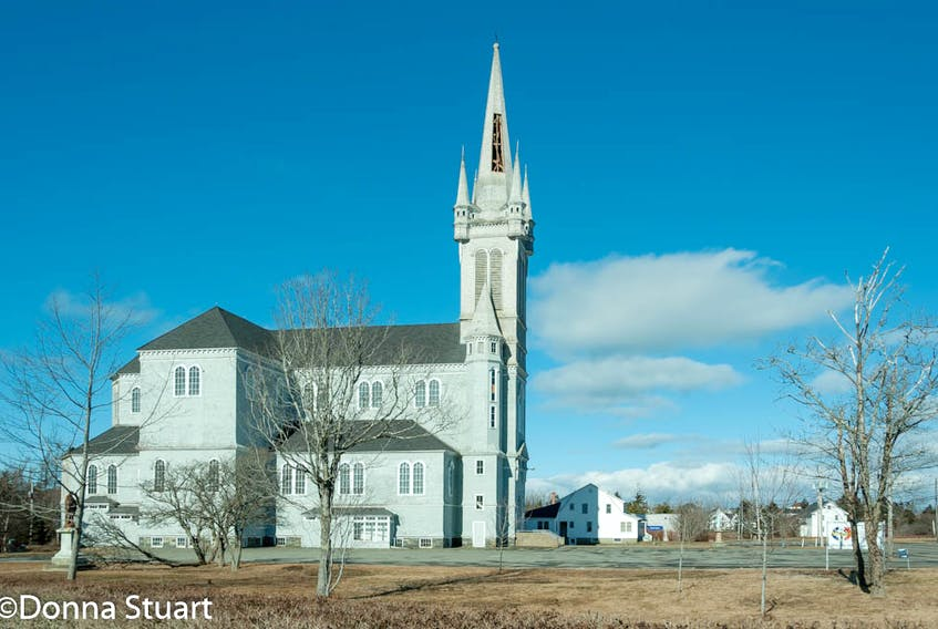The cladding and shingles that were blown off the steeple of the Église Sainte-Marie church building in Church Point, Digby County ended up in a parking lot across the street from the historic, tall structure. DONNA STUART PHOTO