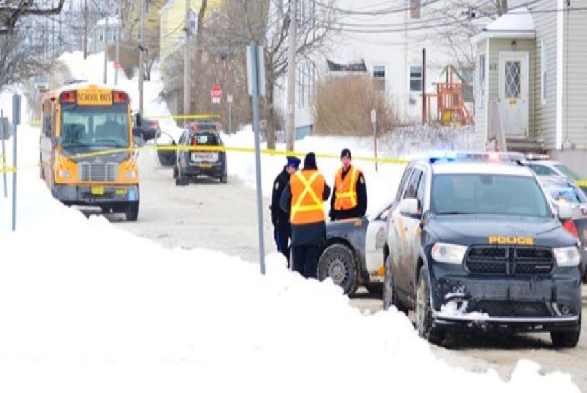 """<span class=""""Normal"""">This file photo shows Sydney Academy at Terrace Street on the afternoon of Feb. 11, shortly after student Christopher Chafe was run over and killed by a school bus. A 15-year-old Sydney Academy student was charged Friday in connection with the fatal accident. <br /></span>"""