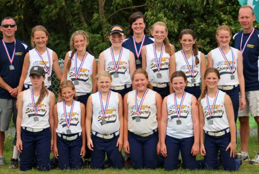 Front row from left: Jenna Hickey, Taylor Long, Christina Bailey, Hannah Fahie, Rory Thompson and Gabby Smith. Middle row: Annika Semple, Kaleigh Foley, Kelsey Hann, Madison Sample, Emily Hayes and Jayden Palmer. Back row: coaches Rob Hayes, Edwina Palmer and Brian Semple.