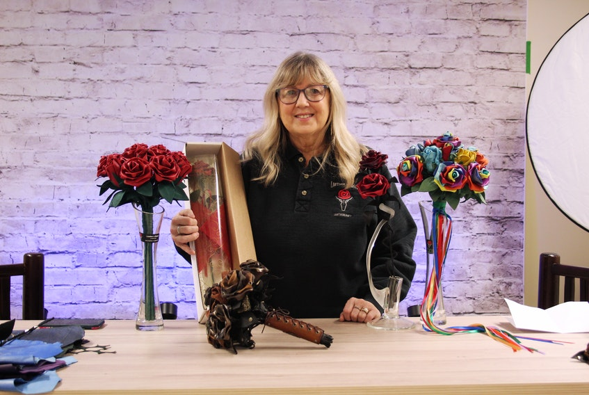 Janet Dodson, along with all the different styles of roses she makes, from classic red roses to rainbow roses for pride month.