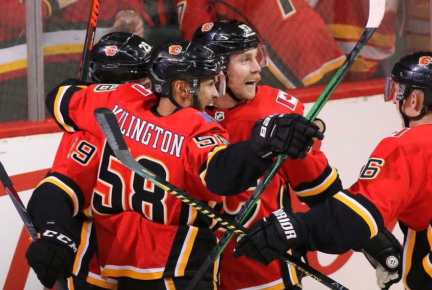 The Calgary Flames celebrate Sam Bennett's first goal on Chicago Blackhawks goalie Robin Lehner during NHL action in Calgary on Saturday, February 15. Photo by  Gavin Young/Postmedia.