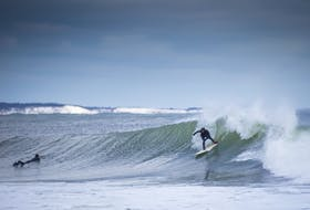 Getting outside is important all year long, and what better way to do just that in Canada's Ocean Playground than by strolling one of its beaches or donning a wetsuit for winter surfing at Lawrencetown Beach? - Photo Courtesy Discover Halifax/Acorn Art Photography.