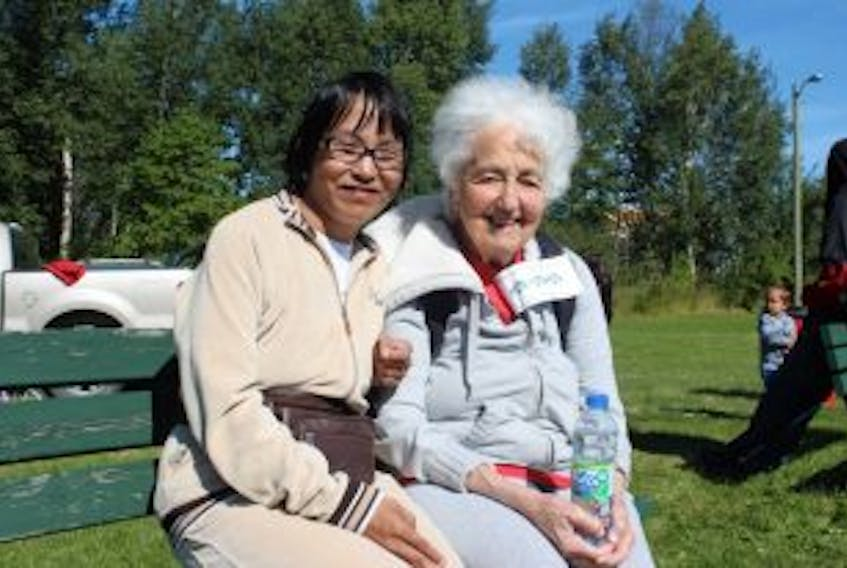 ['Susie Schule (left), and her mother, Regula, came out to the community barbecue in Happy Valley-Goose Bay on Sept. 9, marking International FASD Awareness Day.']