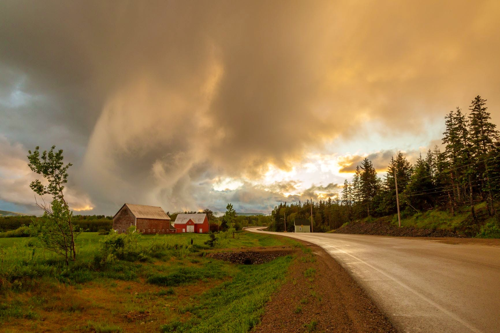 A few of Cyndie's friends advised her to get my take on the ominous-looking cloud in this photo. Cyndie snapped the picture at approximately 8:25 p.m. on June 9, in Middle River, Cape Breton, N.S.