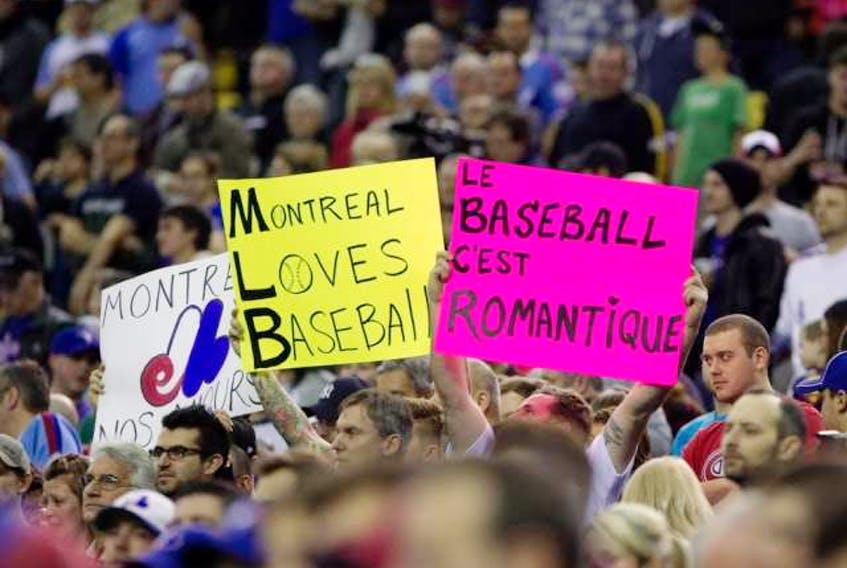 Montreal baseball fans fill the stands during preseason Major League Baseball between the Toronto Blue Jays and the New York Mets at the Olympic Stadium in Montreal on March 28, 2014. ALLEN MCINNIS / MONTREAL GAZETTE FILES