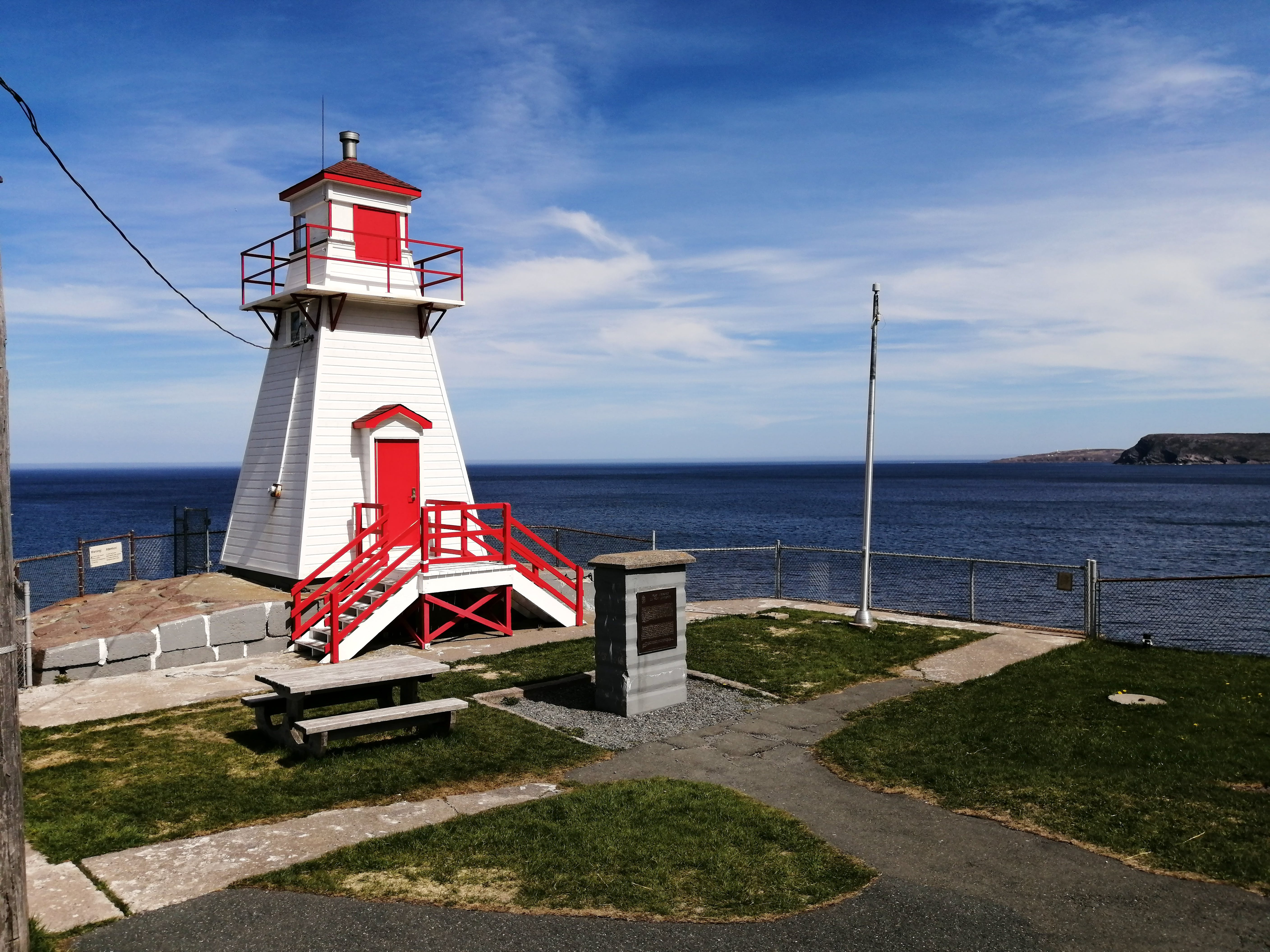 It looks like Gary Mitchell chose a beautiful day to do a little sightseeing. No fog in this lovely photo of the Fort Amherst lighthouse.  This heritage lighthouse is a square, tapered, wooden tower overlooking the Narrows, the channel leading to St. John's Harbour in Newfoundland and Labrador. It is located where Fort Amherst, a British military tower and battery, once stood. This lighthouse was built in 1951 and is the third lighthouse on the site.