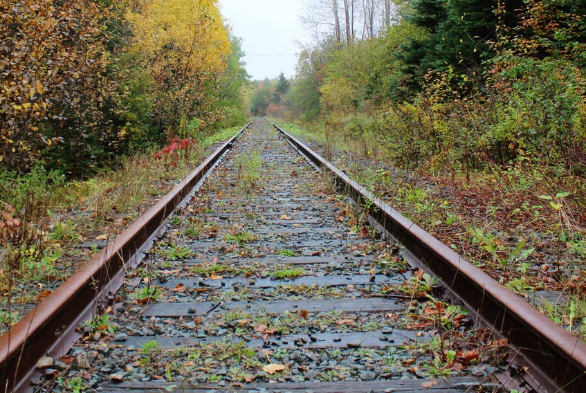 Fall colours and falling leaves frame this portion of the Cape Breton and Central Nova Scotia Railway in Balls Creek from October 2019. The promoters of a proposed Sydney harbour container port say rehabilitating the dormant railway is the last hurdle facing the development.  GREG MCNEIL/CAPE BRETON POST