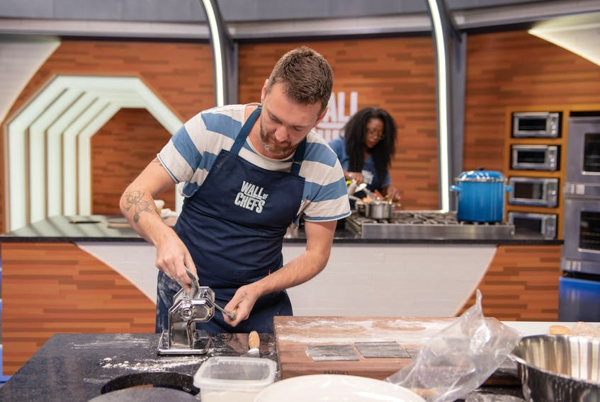 Sydney native Jamie Deveaux rolls out some dough while taking part in the Food Network's Wall of Chefs. Deveaux won the episode and took home a $10,000 prize. CONTRIBUTED/FOOD NETWORK