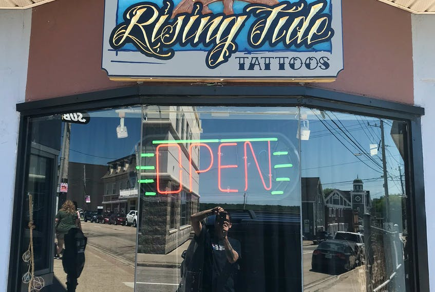 The storefront of The Rising Tide Tattoos which opened on May 1, 2018 at 413 Charlotte Street in Sydney. A structure fire on March 28, 2020 could only be fought externally and firefighters had to demolish the building to extinguish the flames. CONTRIBUTED