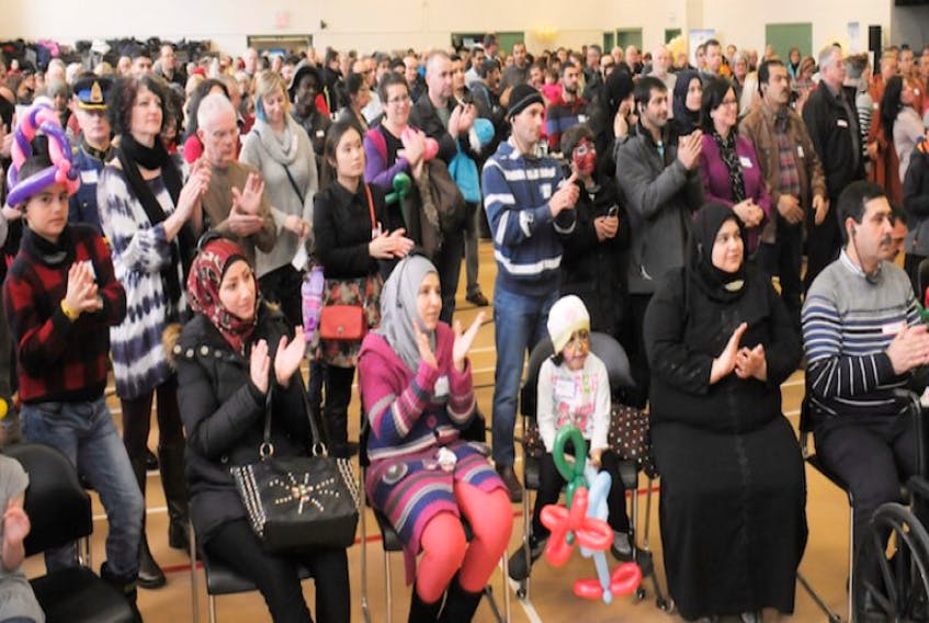 Syrian newcomers attend a recent reception at Murphy's Community Centre in Charlottetown.