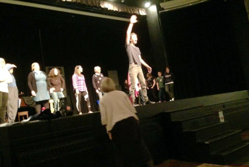 Members of the cast of Take A Bow rehearse for a major musical revue.