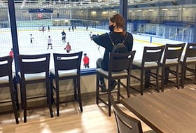 Lauren Pasher is shown overlooking the ice at TALO On Ice, the new sports bar under construction at the Glace Bay Miner's Forum. CONTRIBUTED