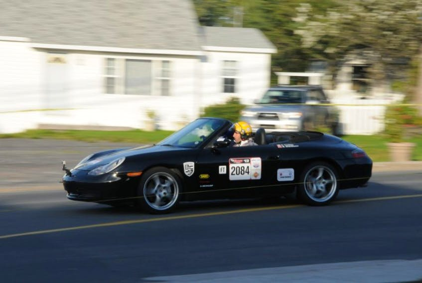A car races through Clarenville during a 2013 Targa event.