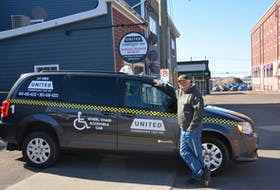 Myles Doucette, manager of United Summerside Taxi Inc., shows off one of the company's wheelchair accessible vans outside the taxi stand. KATIE SMITH/JOURNAL PIONEER