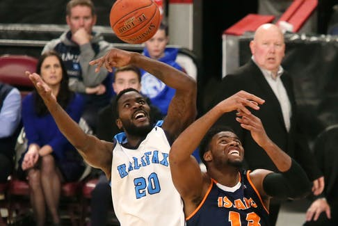 Halifax Hurricanes' Tremayne Johnson, left, and Island Storm's Jalian Haslem fight for a rebound during NBL Canada action iat Scotiabank Centre on Thursday. TIM KROCHAK / The Chronicle Herald