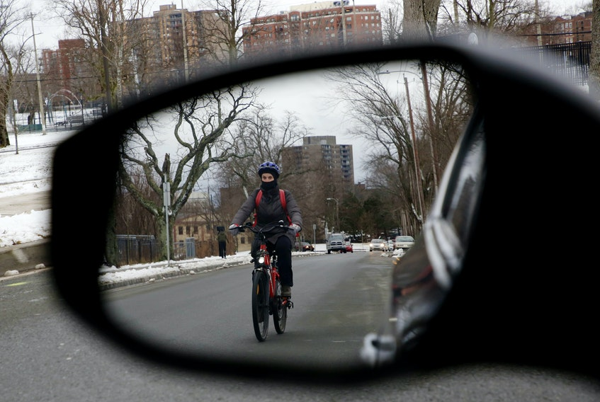 A cyclist is seen in Halifax Monday, Jan. 4, 2021. The Halifax Cycling Coalition has put forward a set of recommendations for the province's Traffic Safety Act and the regulations that accompany it.