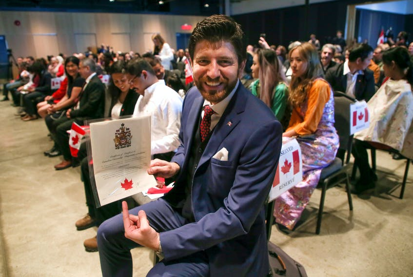 FOR DEMONT STORY: Tareq Hadhad, CEO and founder of Peace by Chocolate, displays his Canadian citizenship, that he had just received in Halifax Wednesday January 15, 2020. Hadhad was one of  50 new citizens sworn in at a special citizenship ceremony held at the Canadian Museum of Immigration at Pier 21.  TIM KROCHAK/ The Chronicle Herald