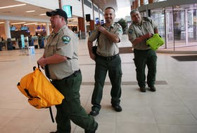 Department of Lands and Forestry firefighters Terry White, Kirk Webster, and Paul Schnurr prepare to depart for Australia, at Halifax Stanfield Airport on Wednesday January 15, 2020. They are joining a Canadian team traveling to Australia to help battle ongoing wildfires.  - TIM KROCHAK