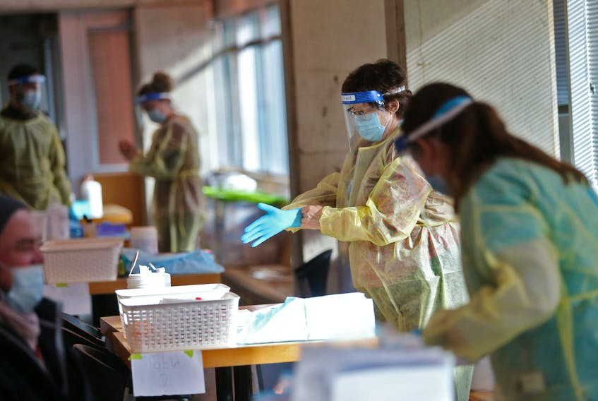 FOR COVID STORY: A testing technician puts on her protective gloves, at a pop-up COVID-19 testing site at Dalhousie University Tuesday January 26, 2021. The unit was conducting the full PCR test.  TIM KROCHAK PHOTO