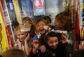 Members of the Halifax South Brownie group, react to the high winds in the hurricane experience capsule in the Ocean Gallery on Wednesdays, free night at the Discovery Centre in Halifax Wednesday February 5, 2020.  TIM KROCHAK/ The Chronicle Herald