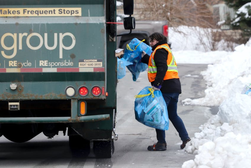 FOR PEDDLE STORY: A worker picks up bags of recycling in St. Margaret's Bay Rd area neighborhood in Halifax Friday February 12, 2021.  TIM KROCHAK PHOTO