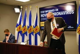 FOR NEWS STORY: Nova Scotia's new Premier, Iain Rankin,  and province's chief medical officer,  Dr. Robert Strang departs after taking part in their first COVID-19 news conference together, in Halifax Wednesday February 24, 2021.  TIM KROCHAK PHOTO