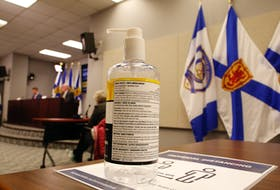 FOR NEWS STORY: A bottle of hand sanitizer is seen as Nova Scotia's new Premier, Iain Rankin,  and province's chief medical officer,  Dr. Robert Strang conduct their first COVID-19 news conference together, in Halifax Wednesday February 24, 2021.  TIM KROCHAK PHOTO