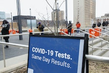 FOR NEWS STORY: Members of the general public, queue for COVID-19 rapid testing, at the central branch of the Public Library in Halifax Monday March 1, 2021.  TIM KROCHAK PHOTO