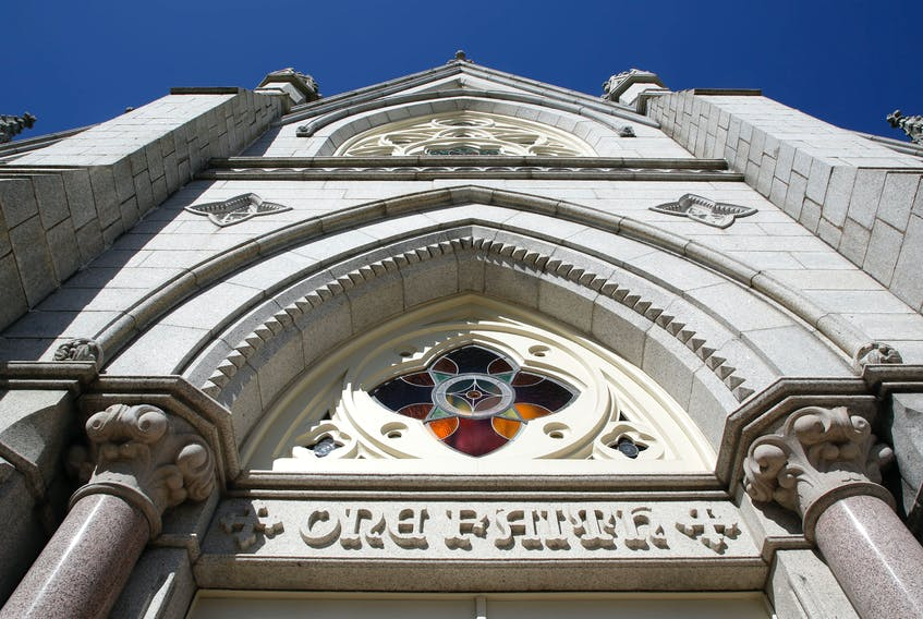 FOR CAMPBELL STORY: ONE FAITH is inscribed above one of the three front doors on St. Mary's Basilica in Halifax Thursday March 4, 2021. For a story on no settlement yet in a class-action lawsuit by local Catholics who say they were abused by priests in the Halifax-Yarmouth diocese.  TIM KROCHAK PHOTO